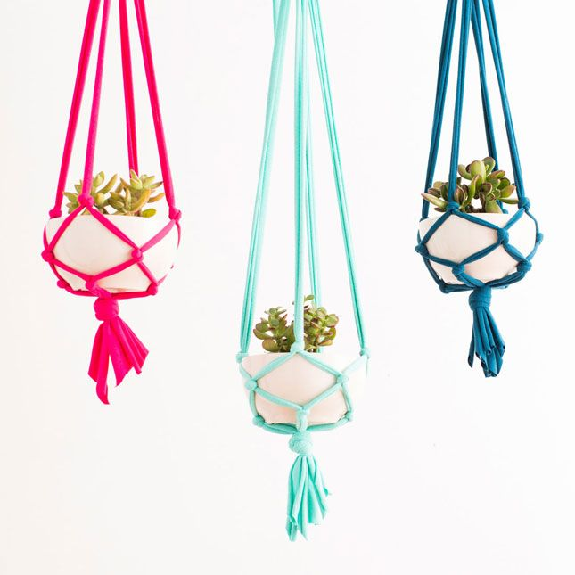 Decorate for spring with colorful macrame hanging planters.