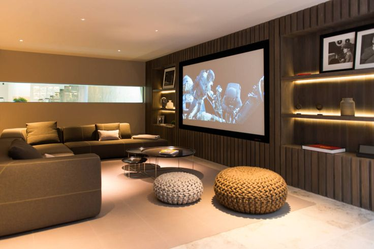 Home cinema and sitting area at Bedford Gardens House. : Modern media room by Nash Baker Architects Ltd