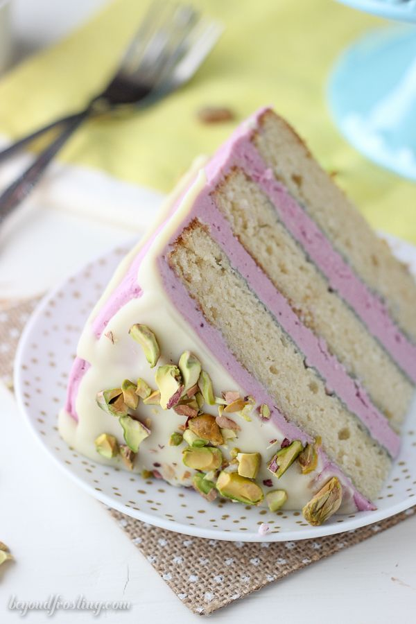 You'll absolutely love this Blueberry Pistachio Layer Cake. Three layers of homemade white cake with a fresh blueberry frosting, a white chocolate ganache and salted pistachios.
