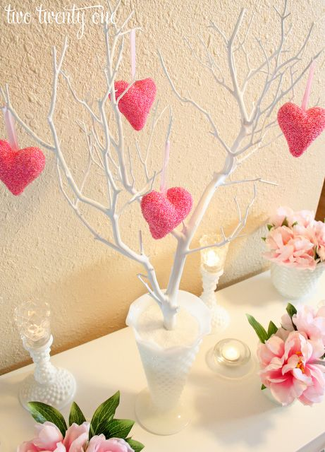 a little tree centerpiece with hanging hearts...I'm liking it... add Vday words or family names...