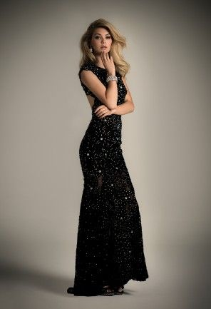 Camille La Vie lace studded dress with a scoop neckline, slight cap sleeve, mesh illusion bodice, a trumpet illusion skirt and an open back.<br><br>•Scoop neckline<br>•Lace and beaded fitted bodice<br>•Trumpet skirt<br>•Open back with single frog closure<br>•Center zipper