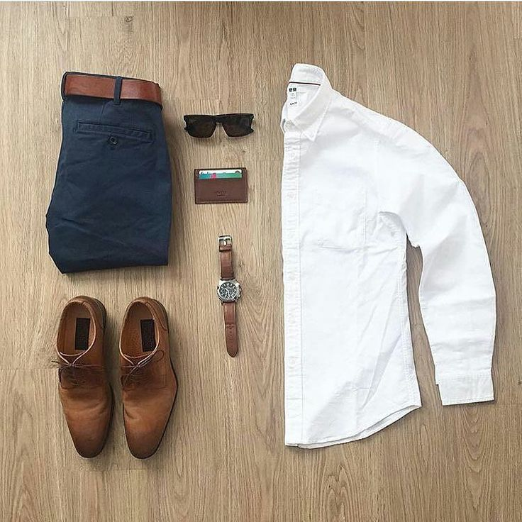 Men's casual outfit. Brown dress shoes, navy chinos, brown belt, white button down, sunglasses, watch.