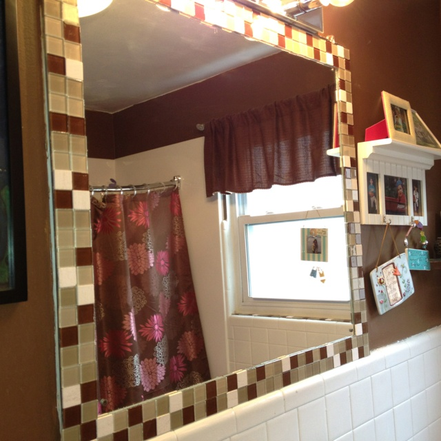 Glass floor tiles...great sale! Used 3 full tile sheets on sale for less than $3. Peeled apart, glued on bathroom mirror with silicone glue...thanks for the idea Pinterest!