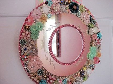 Maybe I should rethink my hesitation about framing my round mirror with the turquoise glass buttons. Could blend them with the other tiles from the Hobby Lobby stained glass supplies section.  Hmmmmmm.  We sure have the jewelry junk to make this. Could be sold. Could do picture frames this way too........