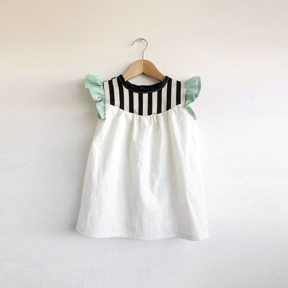 **Please note: current turnaround time is 2 weeks** The bodice of this 100% cotton dress is a lightweight ivory broadcloth with black and cream