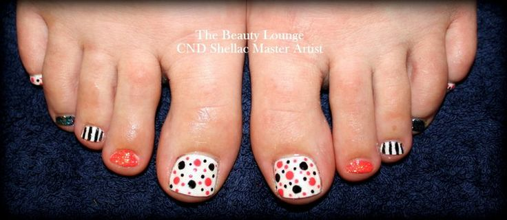 CND Shellac Toes in Topix and Cream puff with Polka dots.  A beautiful coral orange tone.  #cndshellac #nailart #salcombe
