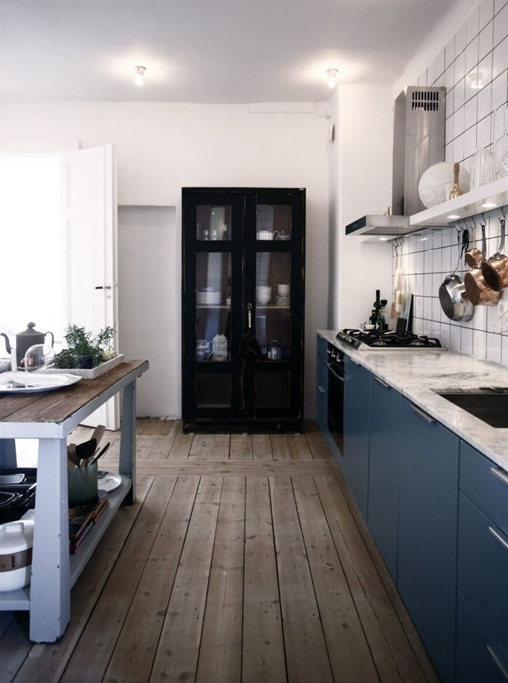 Rustic kitchen with blue cabinets