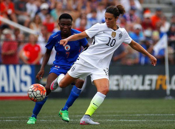 Carli Lloyd and Roselord Borgella of Haiti, Birmingham, Ala., Sept. 20, 2015. (Kevin C. Cox/Getty Images North America)