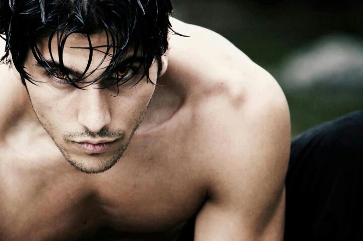 This sexy shirtless guy, with those unusual cinnamon-colored eyes and gorgeous muscles, could totally be a wolf shifter.