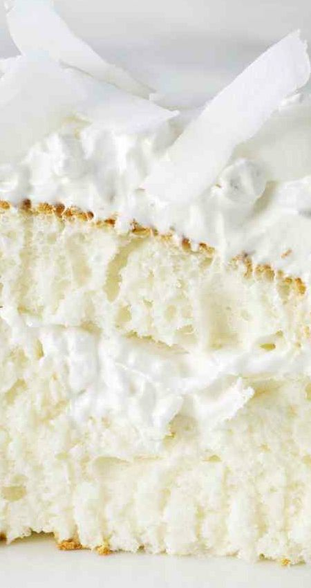 Coconut Cloud Cake ~ This light, flavorful dessert, filled and topped with seven-minute frosting and coconut, is a little slice of heaven