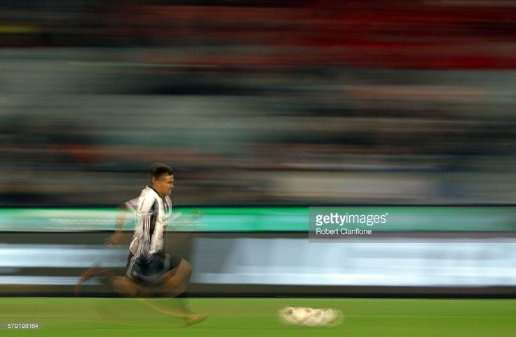 Paulo Dybala of Juventus runs with the ball during the 2016 International Champions Cup Australia match between Melbourne Victory FC and Juventus FC at Melbourne Cricket Ground on July 23, 2016 in Melbourne, Australia.