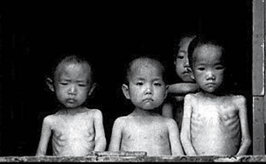 Holocaust in North Korea.                    Children photographed in an orphanage in North Korea during the 1997 famine. The photo was taken by Justin Kilcullen,  former director of Trócaire. www.trocaire.org