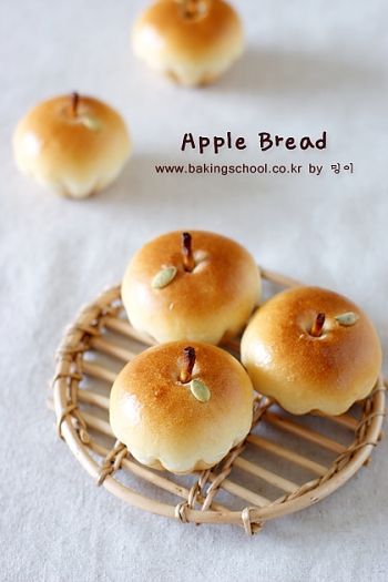 bread shaped like apples! (recipe isn't in English, but looks like pretzel sticks for stems and pumpkin seeds for leaves maybe?)