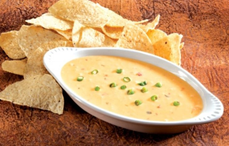 Carlos O'Kellys  Queso  1 lb Velveeta cheese, cubed 1/2 C sour cream Approx 1 10oz can condensed cream of chicken soup 1 C Carlos O'Kellys Salsa Melt cheese in double boiler or microwave, stir often Add sour cream, soup and salsa. Warm to serving temperature.
