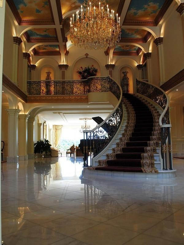 Stunning - would make it a double staircase and would move the grand piano between the stairs to create a classy and symmetrically balanced space