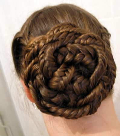 herringbone braided updo - 3 herringbonebraids, braided together and then bunned...looks intricate but actually easy to do