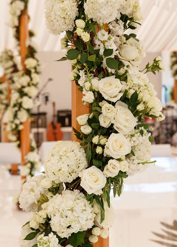 White roses and hydrangeas decorated the columns around the dance floor.