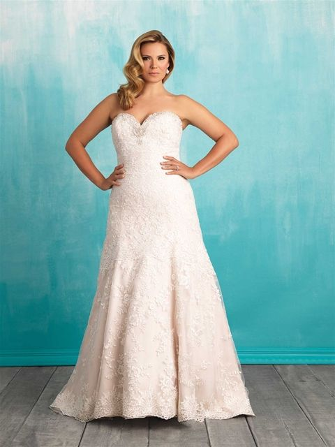 This beautiful piece from Allure Bridals is absolutely perfect! This dress features gorgeous alternating lace patterns and the silhouette accents all the right curves! The stunning sweetheart neckline is covered in simple embellishments and the scalloped lace hem adds the perfect finishing touch!