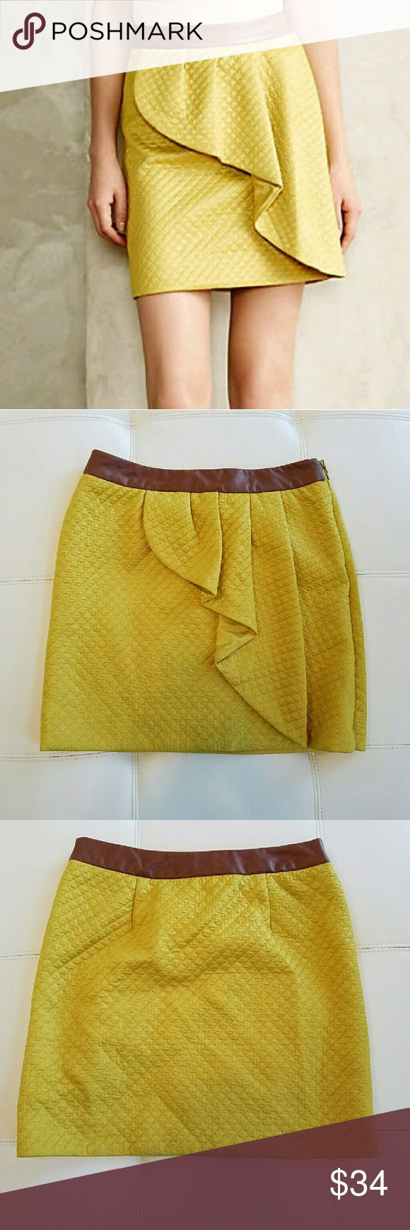 NWOT Anthropologie Lemon Petal Skirt (HD in Paris) This skirt is amaaaazing. Slightly longer than your average mini. Thick, quilted base in mustard lemon yellow petal, with a front ruffle flounce. Cognac faux leather band. Hook & eye side zip closure.  The teensiest nearly invisible hole, the size of a pinhead, in the back of the brown band. See last pic. Gorgeous like-new condition otherwise. Fits TTS.  Peace & Happy Poshing! Anthropologie Skirts Mini