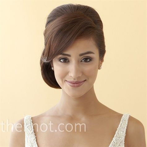 The Side-swept Updo  Side-swept bangs give this formal look a touch of charm.Hair and makeup by Once Upon A Bride