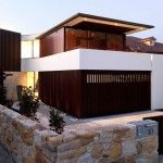 Modern House Front View With Stone Fences