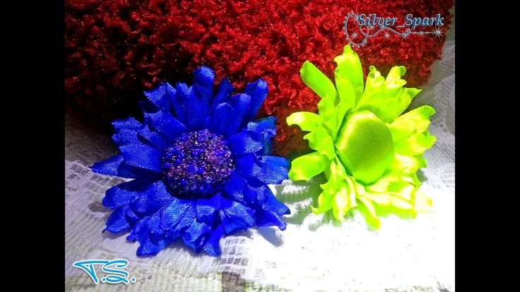 В этом видео мастер-классе я хочу показать, как сделать необычный и симпатичный цветок из атласной ленты.