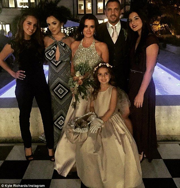 All together: Kyle posed with her daughters and husband by Kris Jenner's pool at the wedding. Her caption read, 'La familia'