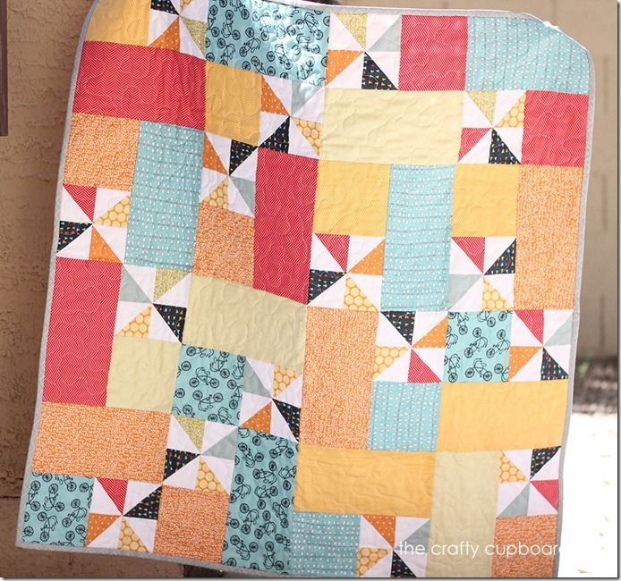 Pinwheel Quilt - like the pattern of the patchwork. Would do a feature fabric instead of pinwheels.