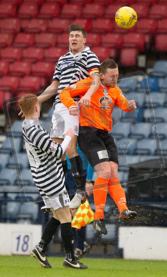 Queen's Park's Sean Burns wins the header during the SPFL League Two game between Queen's Park and Elgin City.