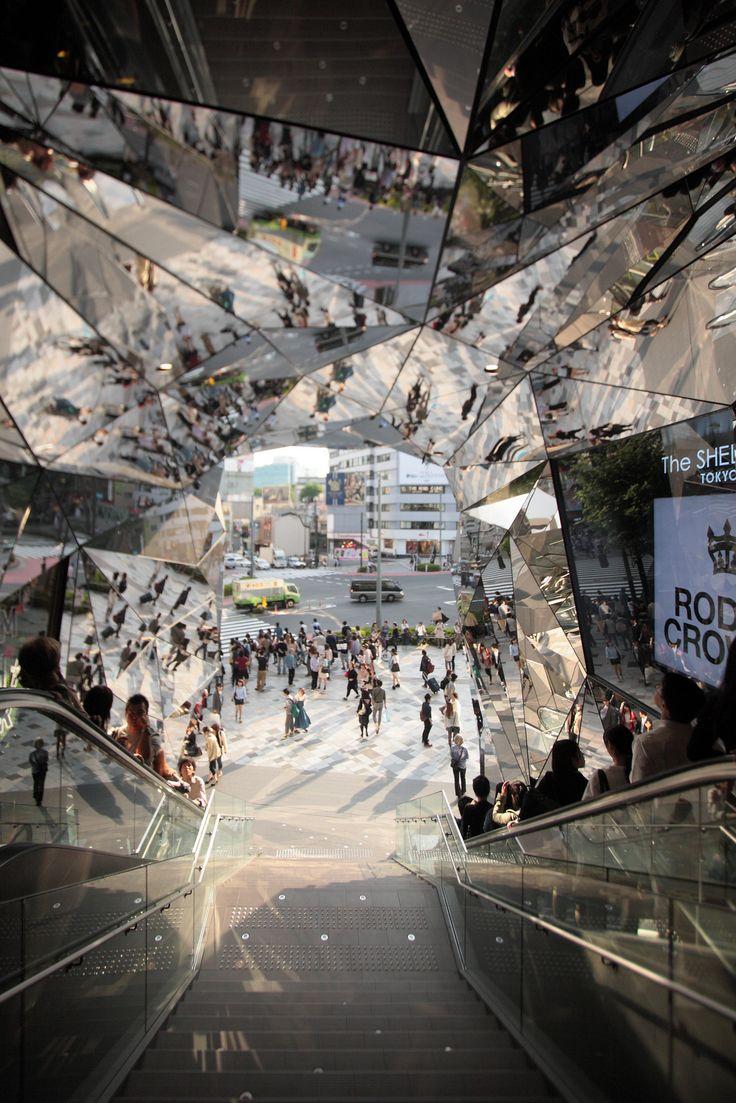 Mirrored entrance to 'Tokyu Plaza Omotesando Harajuku' shopping complex in Tokyo, Japan. Designed by Hiroshi Nakamura.