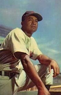 """Lawrence Eugene """"Larry"""" Doby (December 13, 1923 – June 18, 2003) was an American professional baseball player in the Negro leagues and Major League Baseball (MLB). A native of Camden, South Carolina and three-sport all-state athlete while in high school in Paterson, New Jersey, Doby accepted a basketball scholarship from Long Island University. At 17 years of age, he became the Newark Eagles' second basemen."""
