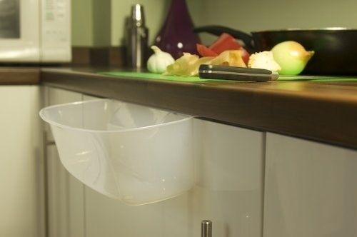 A clever basin that slots into your workspace to easily collect peelings. | 15 Life-Changingly Useful Kitchen Products You Should Know About