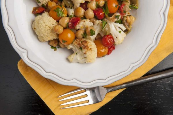 Roasted cauliflower and cherry tomatoes with chickpeas and olives