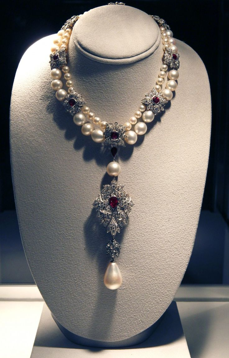 The legendary 16th century pearl, La Peregrina, a gift from Philip of Spain to Mary I. A part of the crown jewels of Spain for generations and ranks as one of the most important historic pearls in the world. This pearl maybe seen, worn by Mary I., in her portraits.     It was purchased by Richard Burton for Elizabeth Taylor in 1969. Recently sold for $11,842,500.00.