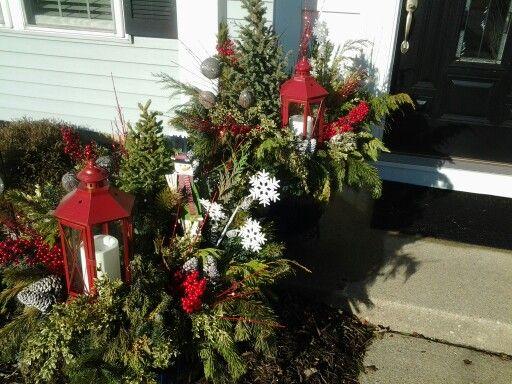 Outside evergreen flower pots