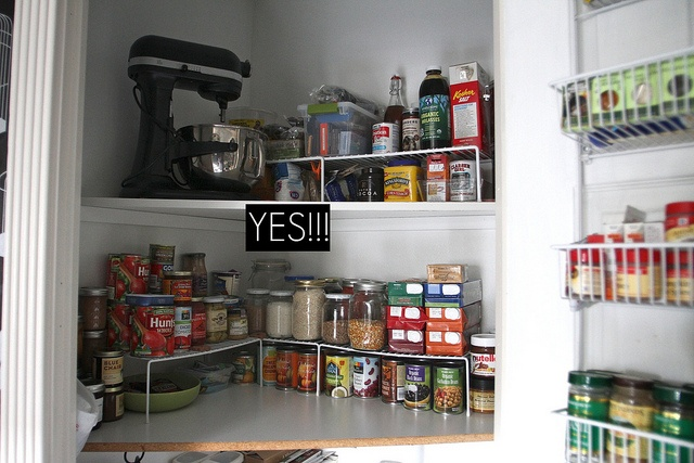 Organising the kitchen cupboards - high straightenence style