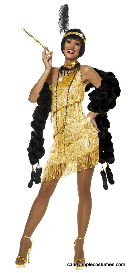 Dazzle as you dance the Charleston in this sexy gold 20's flapper costume! Includes sexy one-shoulder flapper dress with asymmetrical hemline and rows of sparkling gold fringe, gold sequin choker, and gold sequin headband with feather. Beads, boa, cigarette holder, shoes and wig not included.  Costume Suggestions: Roxie Hart, Velma Kelly, Great Gatsby flapper, 70s disco costume, Tina Turner