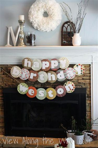 Happy birthday banner over fireplace: DIY project with tutorial. No cutting machine needed.