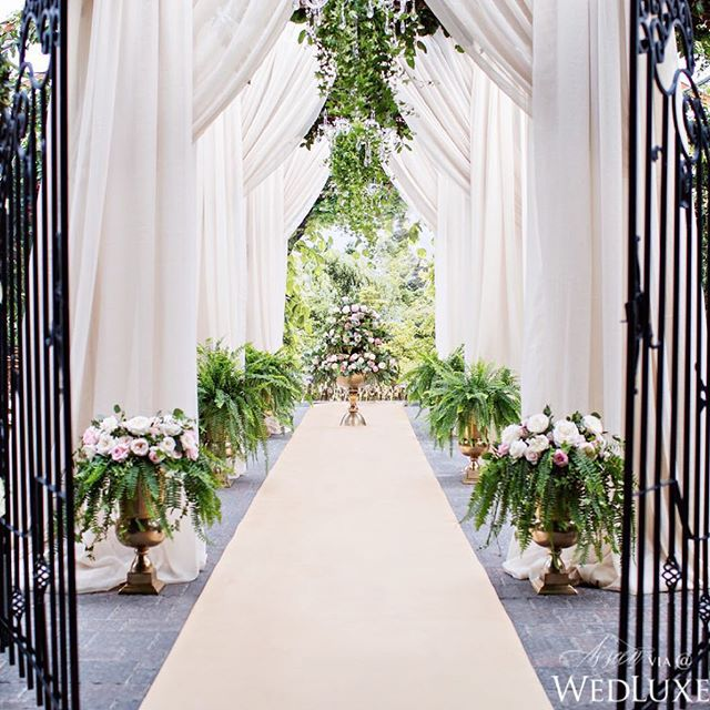 When it comes to making a dramatic entrance, a grand wrought iron gate is an…