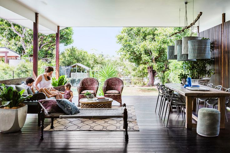 """Eclectic and slightly bohemian, the Dhupelia family's style is resolutely relaxed. """"To blur the transition from indoor to out, we avoided using traditional outdoor furniture,"""" says interior designer Megan Brown, """"and the lounge area was arranged in a typical living room setting, including a rug.""""   **Wicker chairs** from [The Country Trader](http://www.thecountrytrader.com.au/