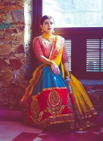 red brocadr blouse, blue and red lehenga, gota patti work, traditional embroidery, yellow and red dupatta