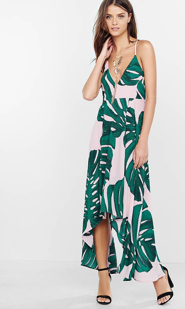 The deep v-neckline, slender straps and open back make this a seriously skin-baring style. Meanwhile, the maxi length skirt, over sized palm leaf print and smooth, flowy fabric give it scads of movement and drama.