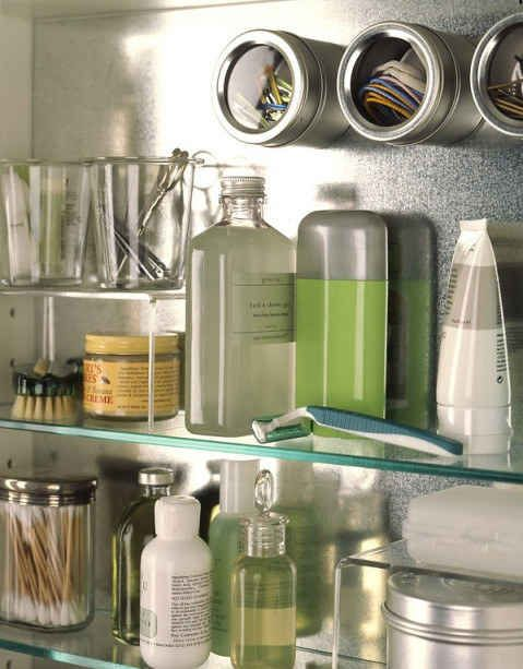 Those magnetic spice canister thingies can be used in the bathroom to hold tiny things like bobby pins and hair ties.