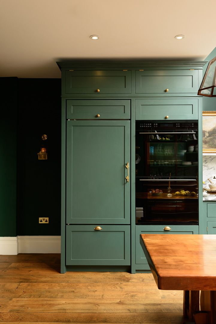 Integrated appliances and beautiful bespoke dark green cabinets in the new Peckham Rye Kitchen by deVOL