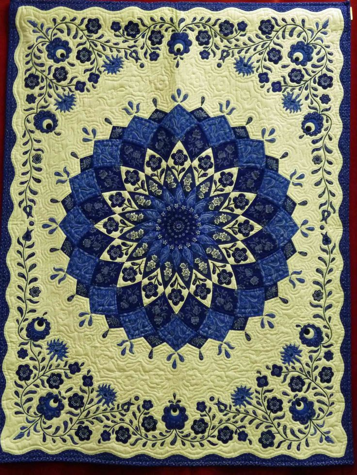 Fabulous blue and white quilt from Hungary... the fussy cutting for the dahlia is wonderful