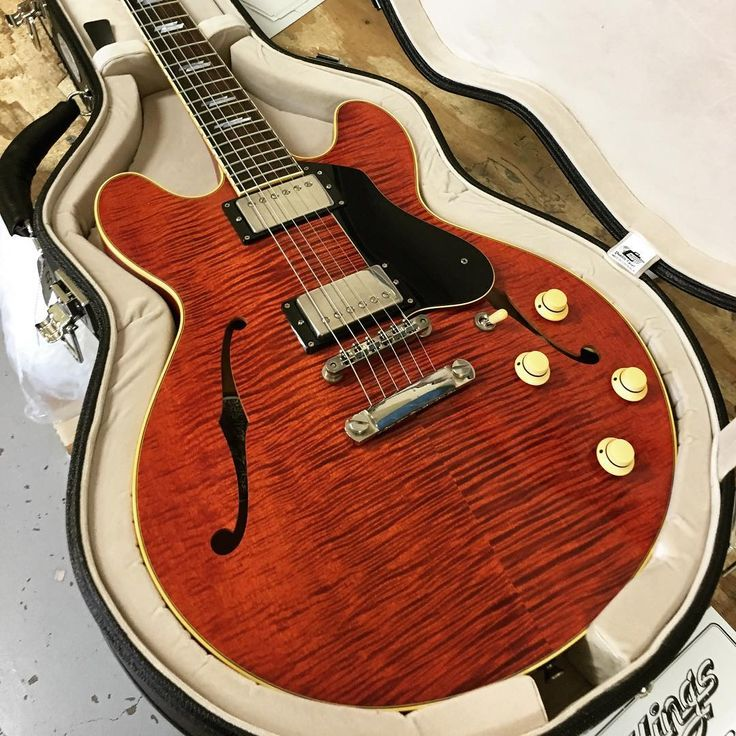 Check out the tightly figured Eastern maple on this Aged Finish I-35 Deluxe in '59 Faded Crimson.
