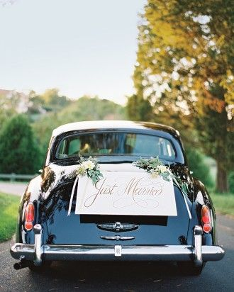 The couple rode away in the family car: a vintage Rolls-Royce, courtesy of the bride's side.