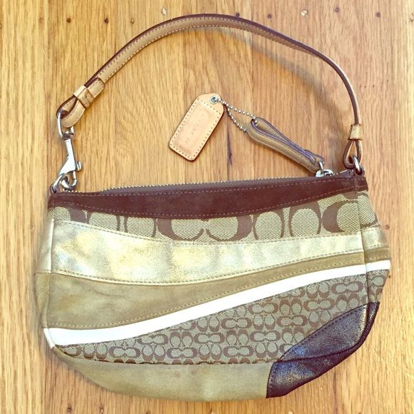 Special edition Coach purse 100% Authentic! Wave patterned Coach purse in brown and metallic gold. Needs some cleaning from use but in good condition. Inside clean no marks. Dust bag is included. Coach Bags Shoulder Bags