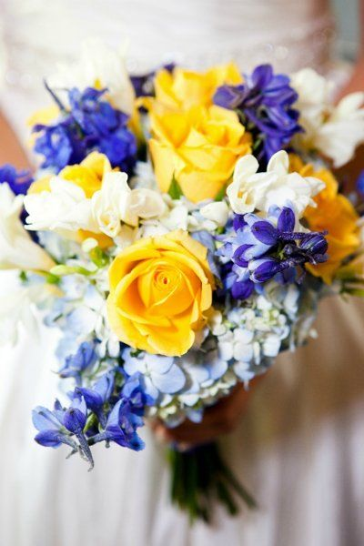 blue and yellow bouquet Idk that I've pinned this before but love all except the roses.. as usual. They're just too stuffy for my outdoor wedding.