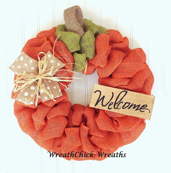 This charming wreath is handmade using quality orange burlap, green burlap, natural burlap secured to a wire frame. A natural burlap bow is combined with a raffia bow is paired with a wood stained Welcome sign. A fun country welcome for your Friends and family.  Measures 19 in diameter To prolong the beauty of your wreath, it is recommended to display under protection of an overhang or porch.  Please know your wreath will be carefully packaged in a sturdy box for shipping. Much pride and…
